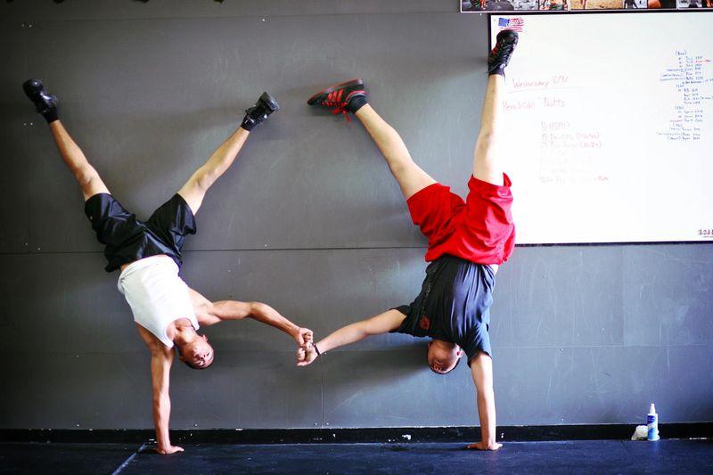 Hand stand pushups team